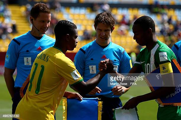 Handshake of peace between Lincoln of Brazil and Kelechi nwakali of Nigeria before the FIFA U17 Men's World Cup 2015 quarter final match between...