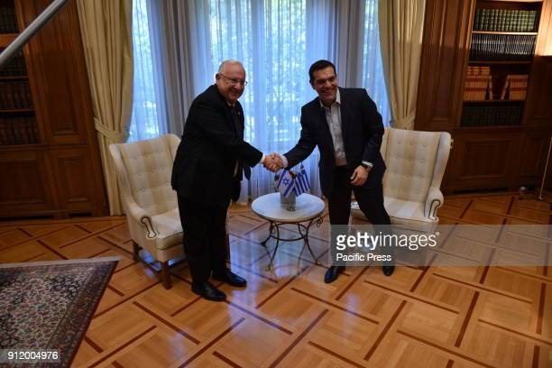 Handshake of the President of israel Reuven Rivlin and Greek Prime Minister Alexis Tsipras during their meeting
