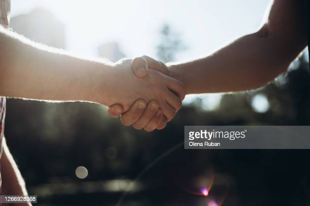 handshake of two men when they meet - final game stock pictures, royalty-free photos & images