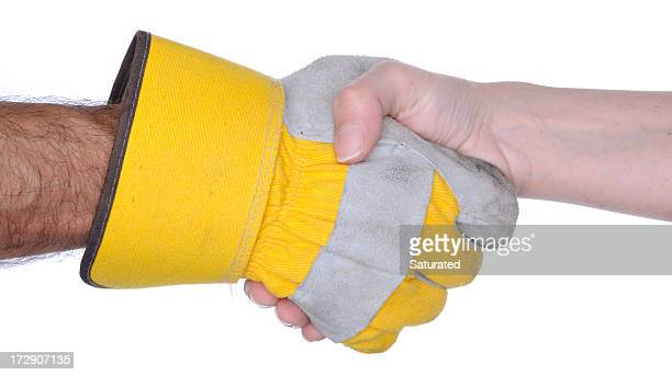 handshake: one hand with work glove - work glove stock photos and pictures