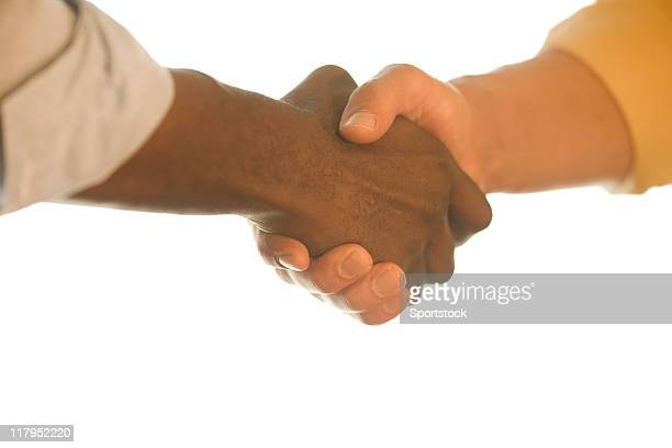 handshake - rolled up sleeves stock photos and pictures