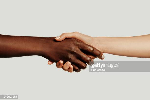handshake - anti racism stock pictures, royalty-free photos & images