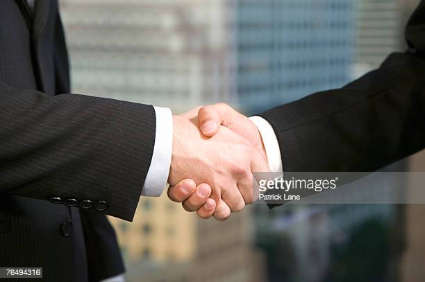 handshake - pinstripe stock pictures, royalty-free photos & images