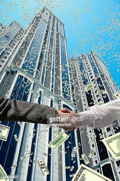 handshake under falling money