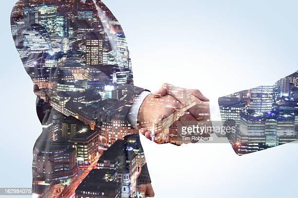handshake with city view at night. - capitali internazionali foto e immagini stock