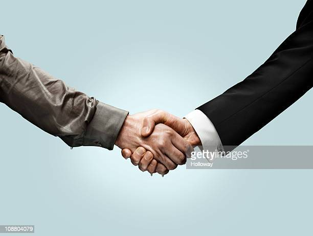 handshakes - handshake stock pictures, royalty-free photos & images