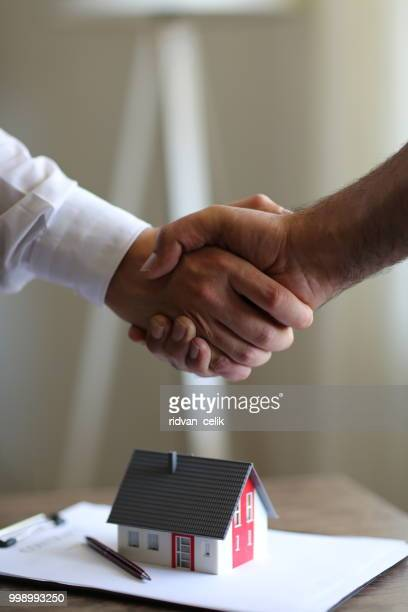 handshakes with customer after contract signature - mortgage stock pictures, royalty-free photos & images