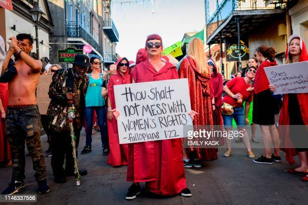 Handsmaid themed protesters march down Bourbon Street in the French Quarter of New Orleans Louisiana on May 25 to protest the proposed Heartbeat Bill...