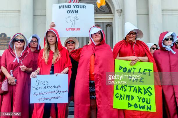 Handsmaid themed protesters stand outside Jackson Square in the French Quarter of New Orleans, Louisiana, on May 25 to protest the proposed Heartbeat...