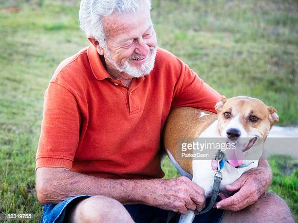 Handsome 79 year old Senior Man Petting His Dog