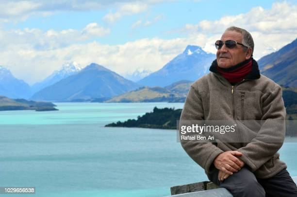 handsome active senior male on travel holiday vacation - rafael ben ari - fotografias e filmes do acervo