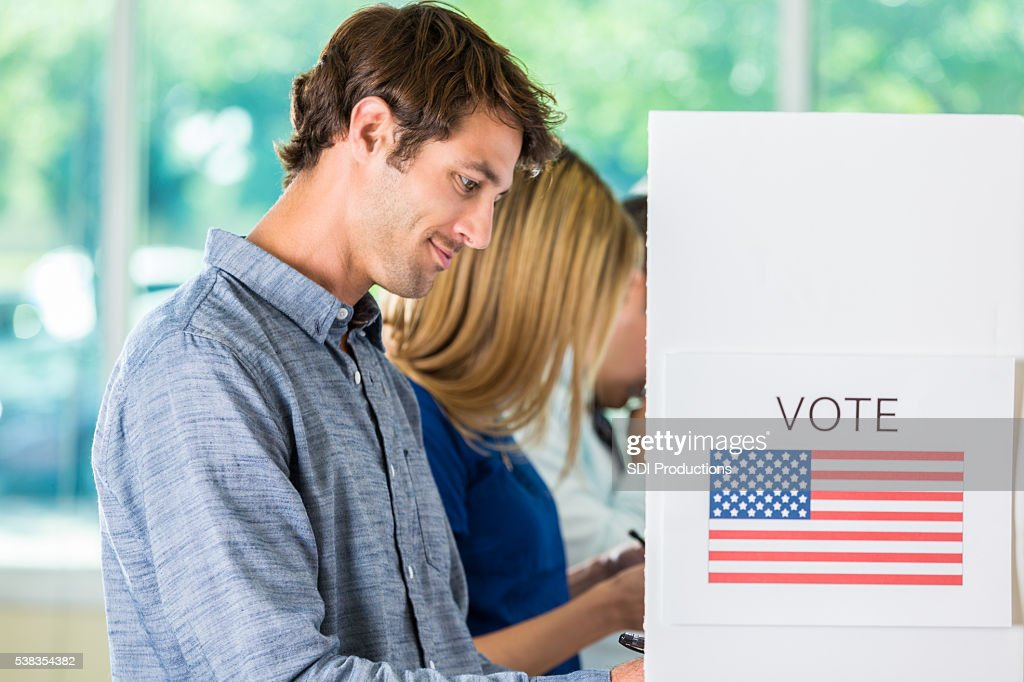 Handsome American man voting : Stock Photo