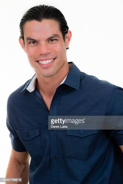 Handsome and confident male in his 30s in casual shirt smiling'n