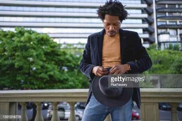 handsome and elegant african american hipster with a hat - whistle stock pictures, royalty-free photos & images