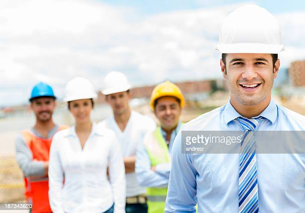 Handsome architect and workers