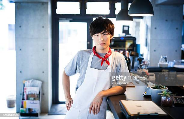 Handsome Asian Cook Leaning on a Bar Counter