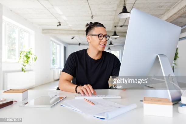 handsome asian man working in the creative workplace - hipster culture stock pictures, royalty-free photos & images