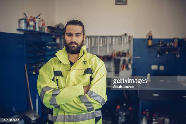 handsome auto mechanic - reflective clothing stock pictures, royalty-free photos & images