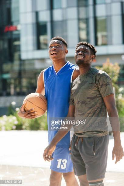 Handsome basketball players walking and looking at something in the air