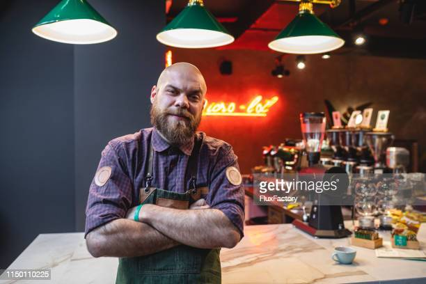 handsome bearded barista at a cafe - bartender stock pictures, royalty-free photos & images