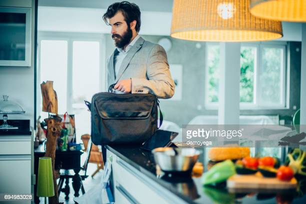 handsome bearded businessman coming home frome work - arrival stock pictures, royalty-free photos & images