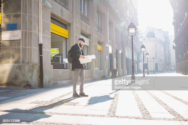 Handsome bearded businessman commuting to work