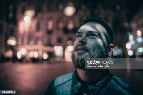 Handsome Bearded Man Enjoy the Beautiful Hologram Presentation in the Night