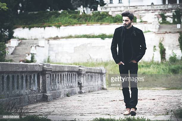 handsome bearded man on the bridge. - stubble stock pictures, royalty-free photos & images