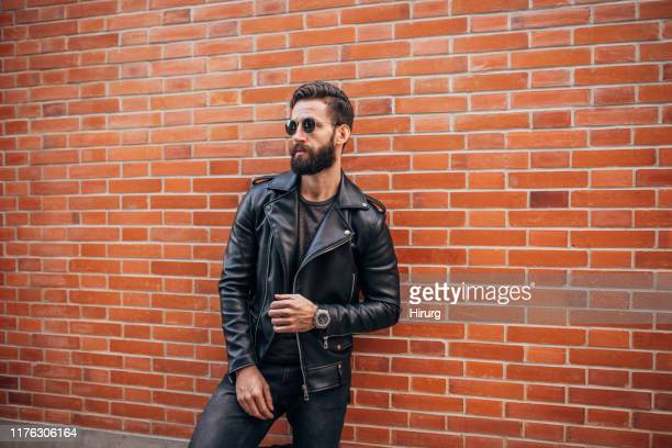 handsome bearded man - black coat stock pictures, royalty-free photos & images