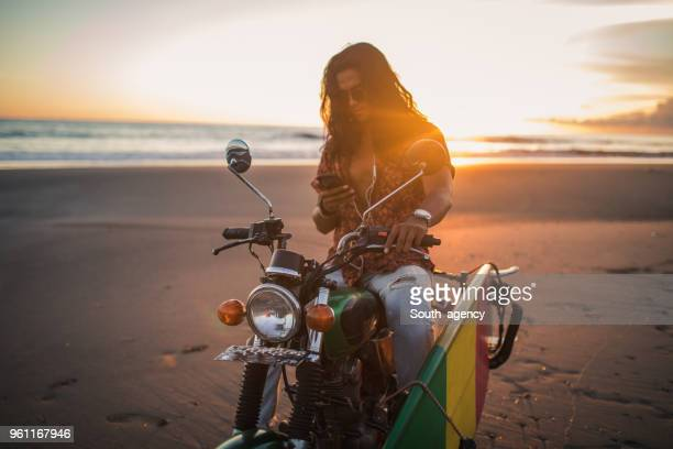 handsome biker - muscle men at beach stock photos and pictures