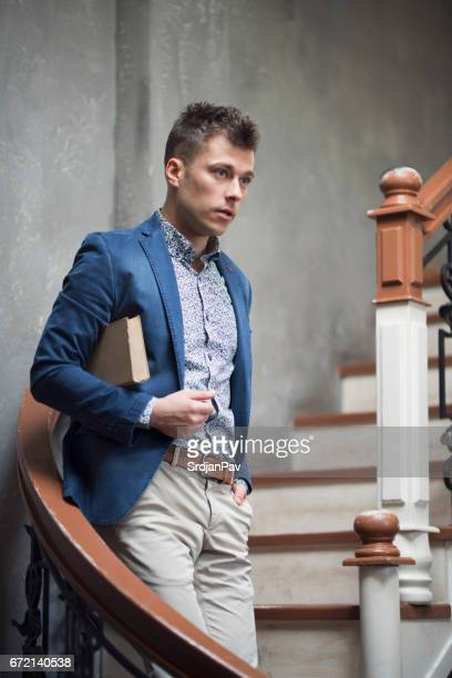 handsome bookworm - menswear stock pictures, royalty-free photos & images