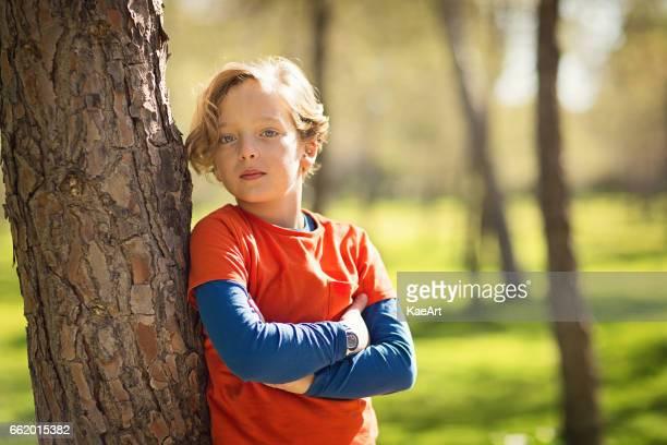 Handsome boy in green park