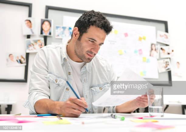 Handsome business man working at a creative office