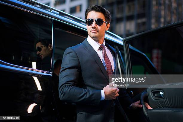 handsome businessman arriving in executive car - new york celebrity stock photos and pictures