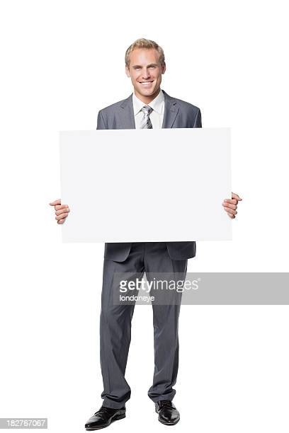 Handsome Businessman Holding a Blank Sign
