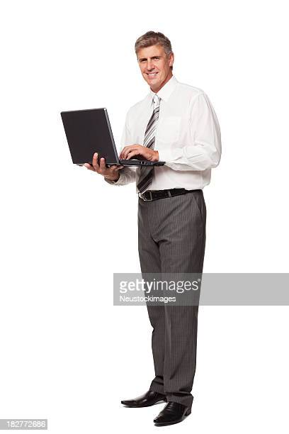 Handsome Businessman Holding a Laptop. Isolated