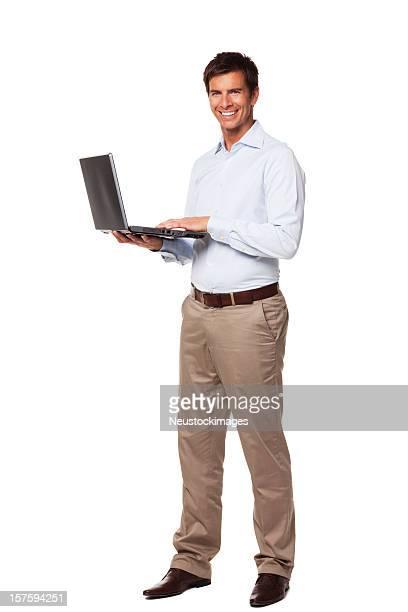Bel homme d'affaires tenant un ordinateur portable. Isolé