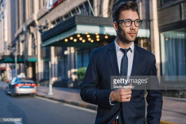 handsome businessman in suit - handsome asian guy stock photos and pictures