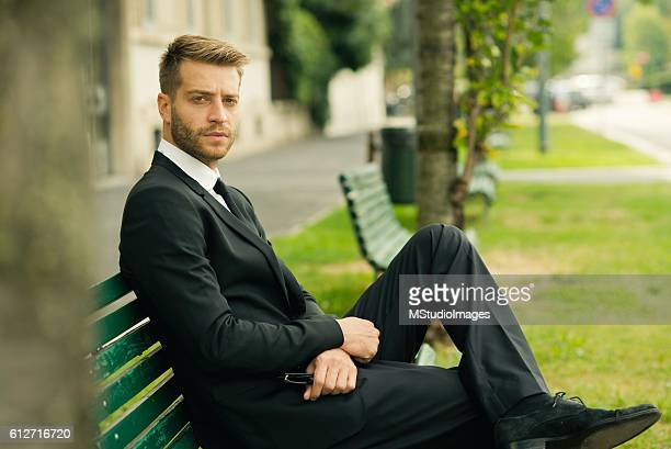 Handsome businessman looking at camera.