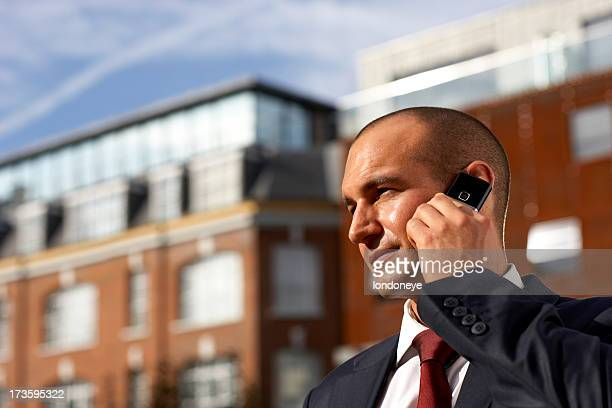 Handsome businessman on the phone.