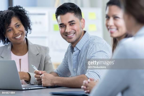 Handsome businessman participates in meeting