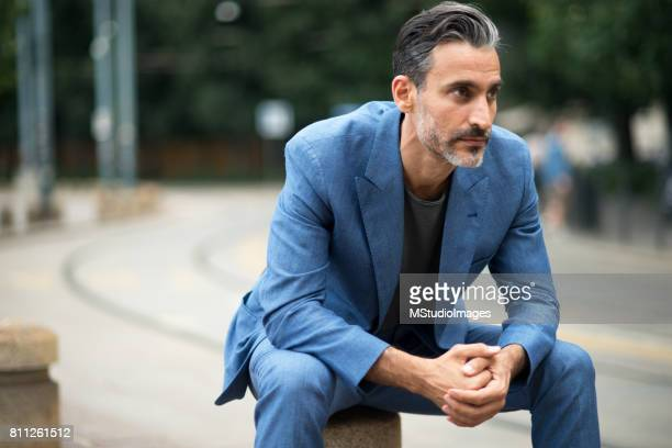 handsome businessman. - milan street style stock photos and pictures