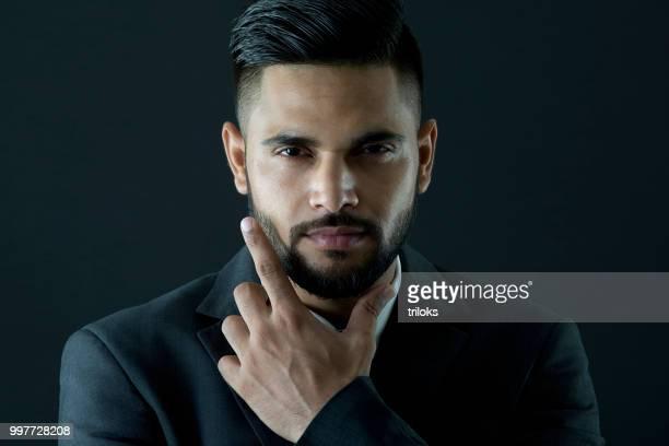 portrait handsome businessman with hand chin