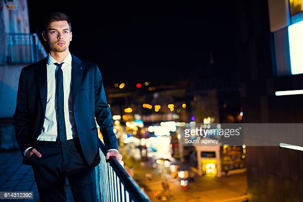 Handsome businessman posing on the top of building