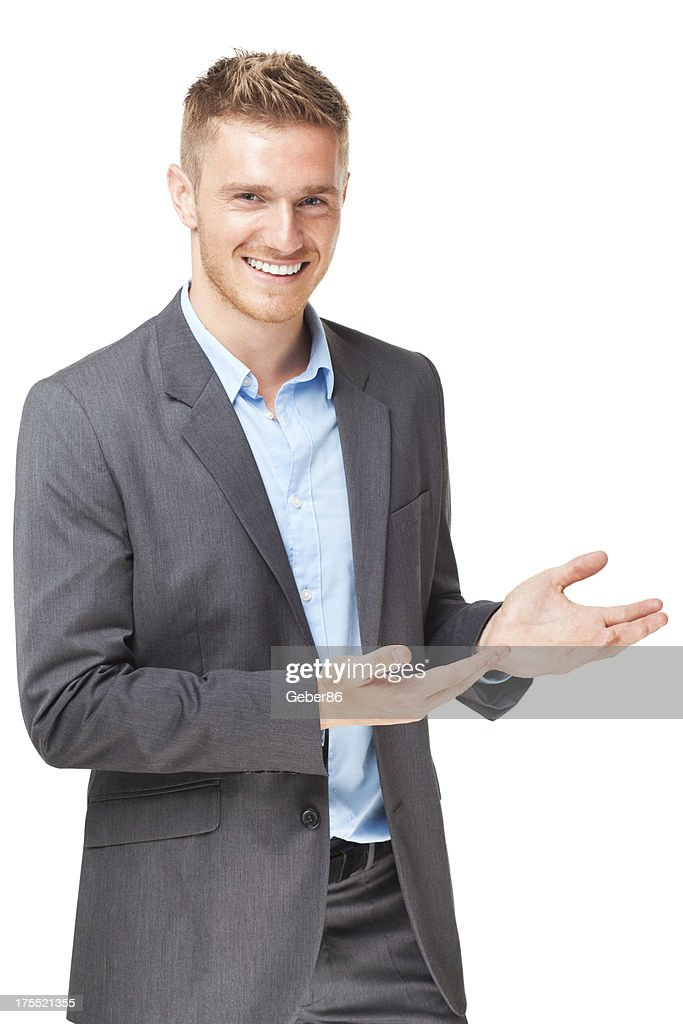 Handsome businessman presenting over white background : Stock Photo