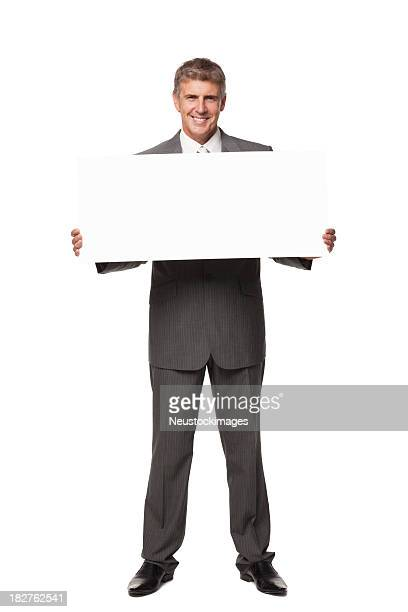 Handsome Businessman Smiling and Holding Blank Sign. Isolated