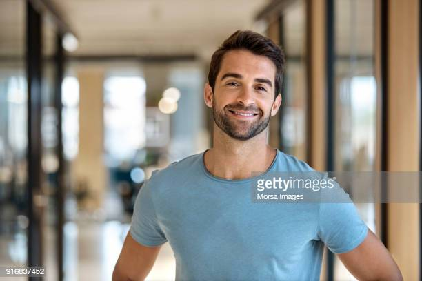 Handsome businessman smiling in office