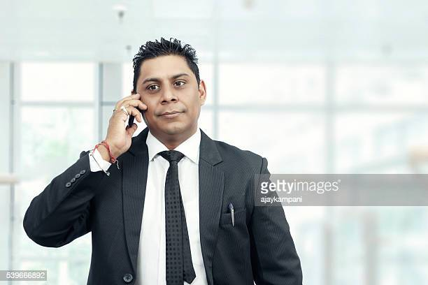 handsome businessman talking on phone