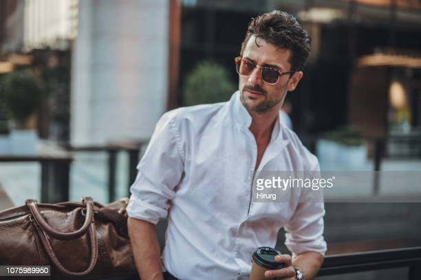 handsome businessman wearing sunglasses - leather shirt stock pictures, royalty-free photos & images