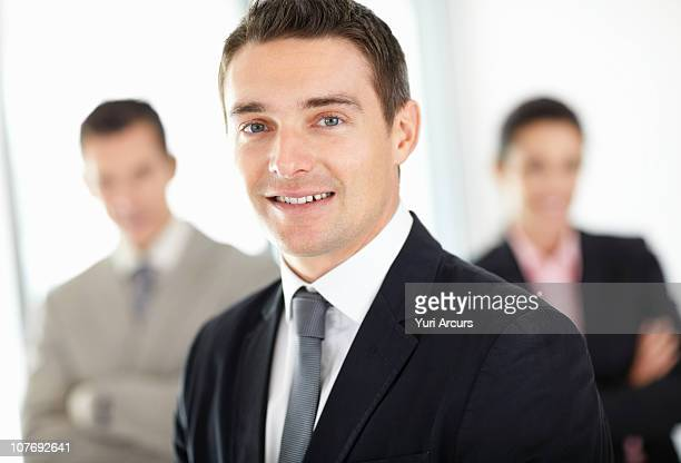 handsome businessman with colleagues - number of people stock photos and pictures